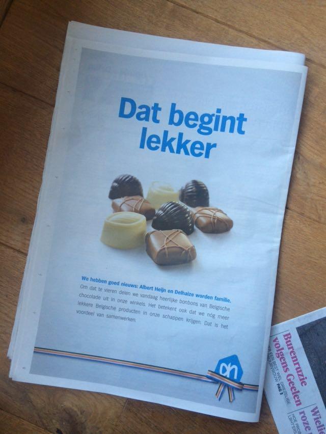 Advertentie Albert Heijn en Delhaize over weggeven bonbons